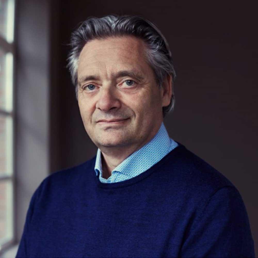 Male person standing in front of window looking at the camera. Marc Vanschoenwinkel